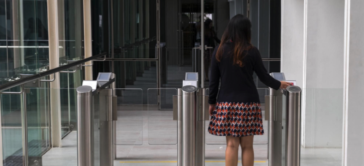 Women entering building scanning ID - Physical Security