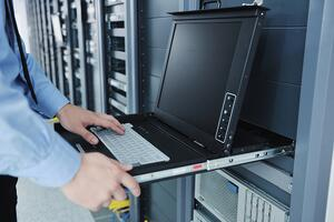 Business man engineer using asset locker in server room